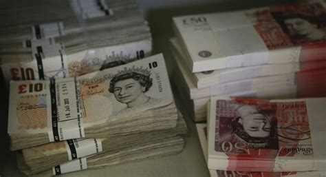 Sterling falls to 17-month low vs dollar ahead of BoE rate
