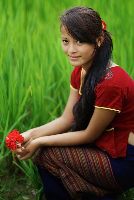 Thaman Nepali girl with flower, Chitwan National Parc
