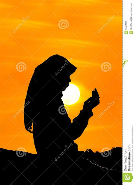 Silhouettes Of A Women Praying Stock Photo - Image of